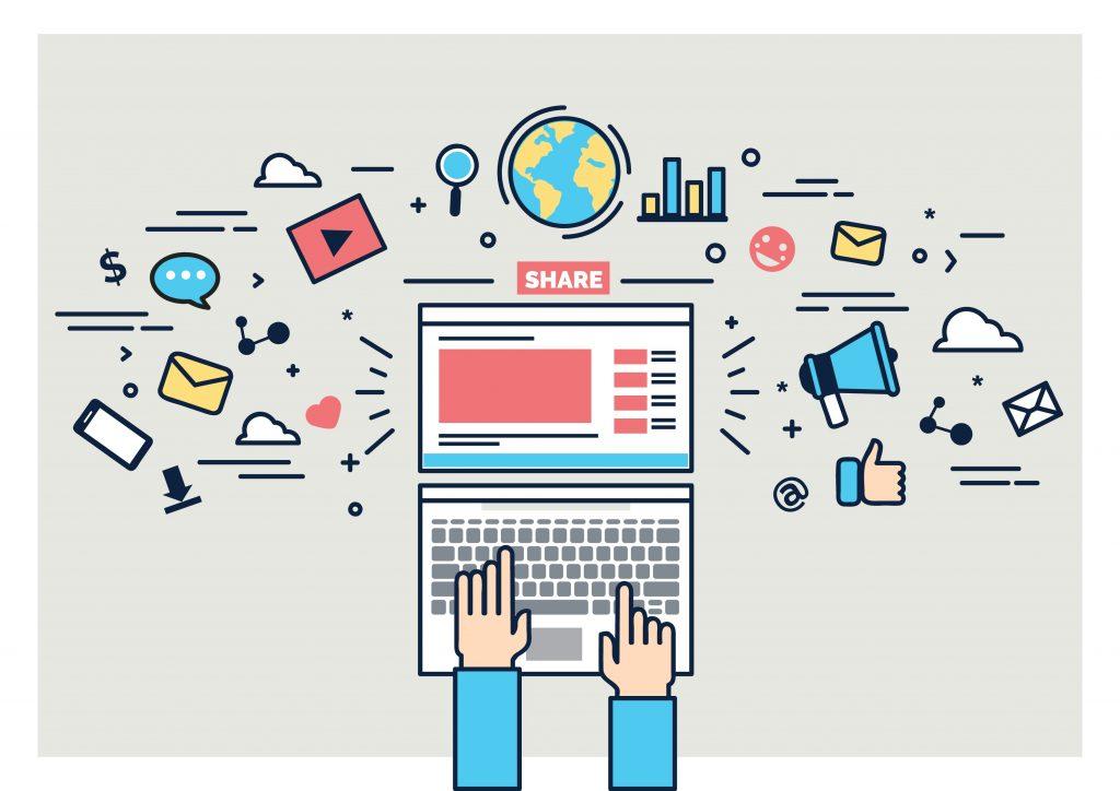 digitális eszközöket használó kéz egy laptop billentyűzetén